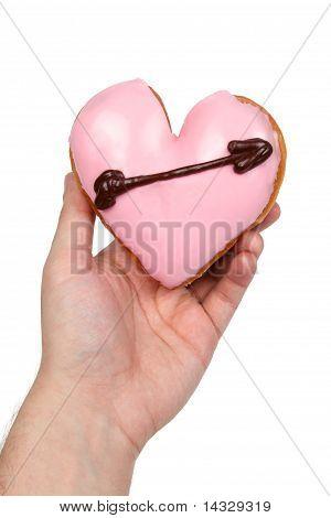 Hand Holding Heart Shaped Donut