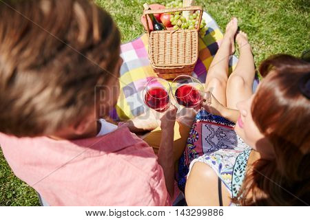 Couple Drinking Wine While Picnicking