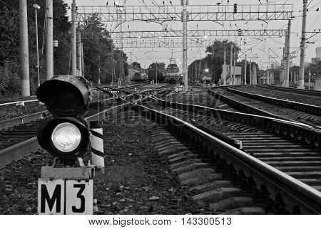 semaphore on the railway in the summer black and white