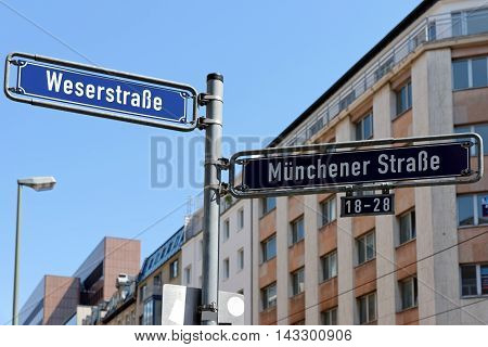 Munchener street and Weserstrasse street sign post a downtown streets in Frankfurt am Main Germany.
