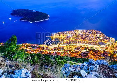 Dubrovnik Croatia. Spectacular twilight picturesque view on the old town medieval Ragusa and Lokrum island on Dalmatian Coast.