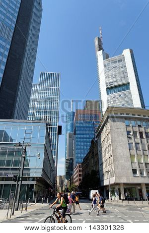 FRANKFURT AM MAIN GERMANY - AUGUST 7 2015: The financial district with the high rise buildings - Eurotower Taunus tower Commerzbank.