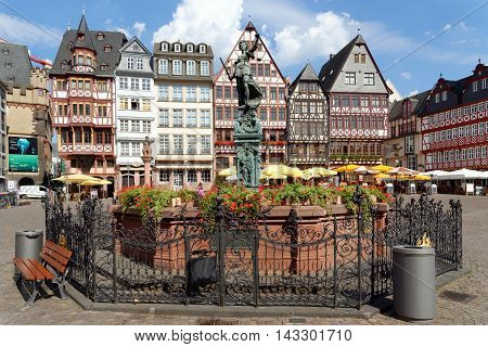 FRANKFURT AM MAIN GERMANY - AUGUST 7 2015: Romerberg square (Roman Mountain) the historic heart of the city and the centre of the old town with the Fountain of Justice in the middle.
