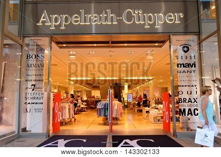 FRANKFURT AM MAIN GERMANY - AUGUST 7 2015: Appelrath Cupper store on Zeil at night. Fashion retailer with 13 stores throughout Germany offers large variety of brands.