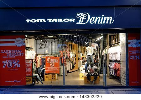 FRANKFURT AM MAIN GERMANY - AUGUST 7 2015: Tom Tailor store on Zeil at night. It is a German vertically integrated lifestyle clothing company headquartered in Hamburg.