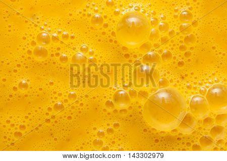 Beaten egg yolks surface in studio shot