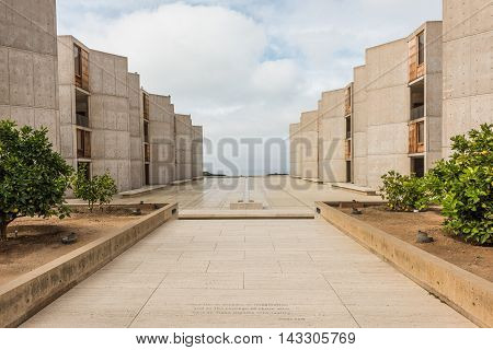 La Jolla, USA - December 10, 2015: Symmetrical architecture of the Salk Institute in San Diego with orange citrus trees