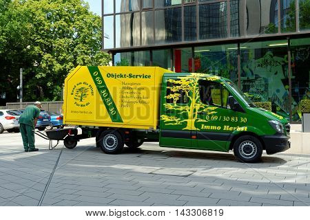 FRANKFURT AM MAIN GERMANY - AUGUST 6 2015: Immo Herbst Objekt services Company vehicle in the central business district of Frankfurt.
