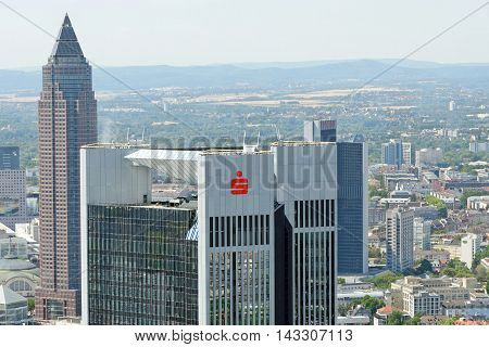 FRANKFURT AM MAIN GERMANY - AUGUST 6 2015: Aerial view of the Trianon and Messeturm skyscrapers from the observatory deck of the Mian tower skyscraper. Frankfurt is the largest financial centre in continental Europe.