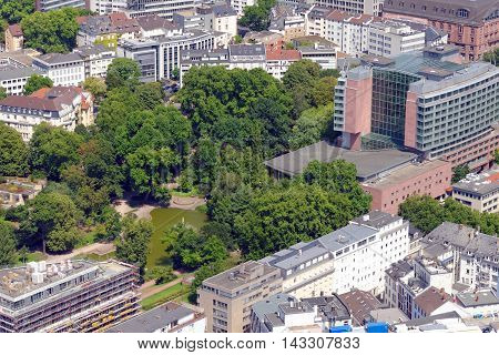 FRANKFURT AM MAIN GERMANY - AUGUST 6 2015: Aerial view of Hilton hotel and Bockenheimer Anlage part of the annular green area around the city formed by the Frankfurter ramparts.