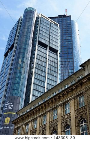 FRANKFURT AM MAIN GERMANY - AUGUST 6 2015: Eurotheum on Neue Mainzer street a 31-storey 110 m skyscraper with office and residential space. Main Tower at the back.