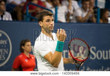 Mason Ohio - August 15 2016: Grigor Dimitrov in a first round match at the Western and Southern Open in Mason Ohio on August 15 2016.