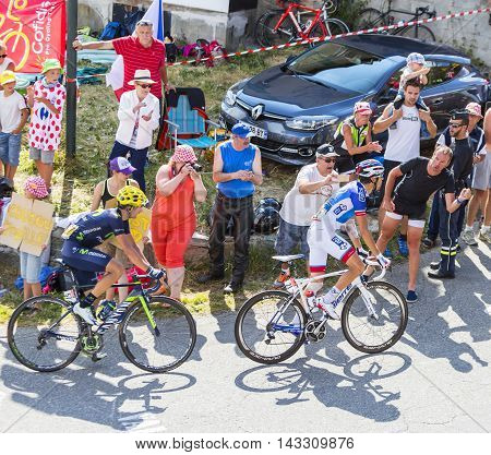 Col du Glandon France - July 23 2015: Thibaut Pinot of FDJ Team and Izagirre Insausti of Movistar Team riding in a beautiful curve at Col du Glandon in Alps during the stage 18 of Le Tour de France 2015.