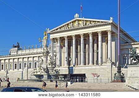 VIENNA, AUSTRIA - SEPTEMBER 01, 2015: austrian parliament building and Pallas Athena fountain in front, Vienna on september 02, 2015