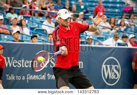 Mason, Ohio - August 16, 2016: John Isner in a match at the Western and Southern Open in Mason, Ohio, on August 16, 2016.