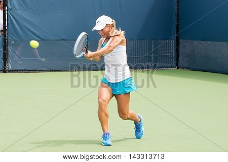 Mason Ohio - August 16 2016: Yulia Putintseva in a match at the Western and Southern Open in Mason Ohio on August 16 2016.