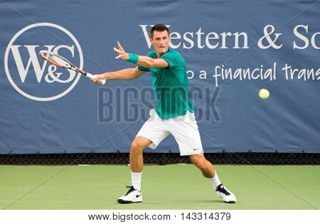 Mason Ohio - August 16 2016: Bernard Tomic in a match at the Western and Southern Open in Mason Ohio on August 16 2016.