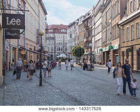 JELENIA GORA POLAND - AUGUST 19 2016: Tourists Walking Through Historic Downtown in Jelenia Gora Poland