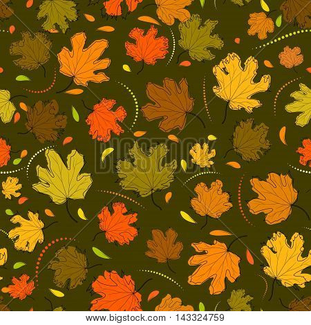 Autumn seamless pattern of colored maple leaves on a background color of withered grass