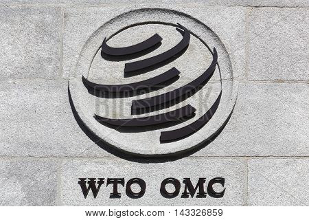 Geneva, Switzerland - August 14, 2016: The World Trade Organization sign on a wall. The World Trade Organization also called WTO is an intergovernmental organization which regulates international trade