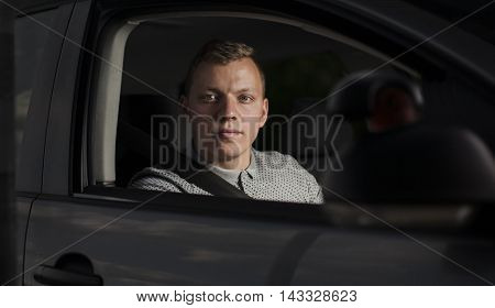 Driving school - driving instructor in his car
