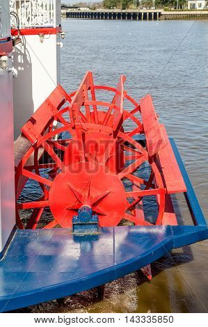 A Red Paddle on a River Boat