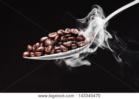 Spoon Coffee On Black Background With Smoke
