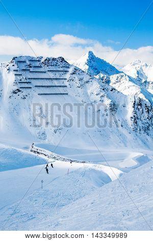 Avalanche snow bridges and ski slope in mountain ski resort Kals-Matrei, Austria - winter sports and beautiful nature.