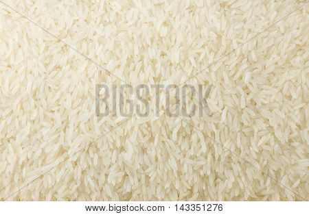 Cuisine and Food Background of Uncooked White Long Rice Basmati Rice or Jasmine Rice.