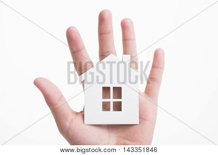 Hand and finger holding white paper house isolated on white background. for business advertisement family home concept