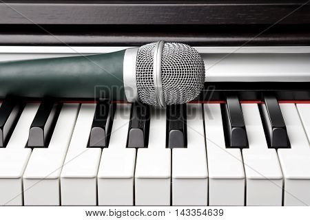 Black and white piano keys and classic microphone