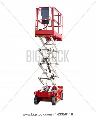 Mobile aerial work platform - red and white scissor hydraulic self propelled lift on light background.