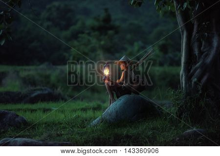 Boy holding Lamp looking. Abstract meaning hope of life.