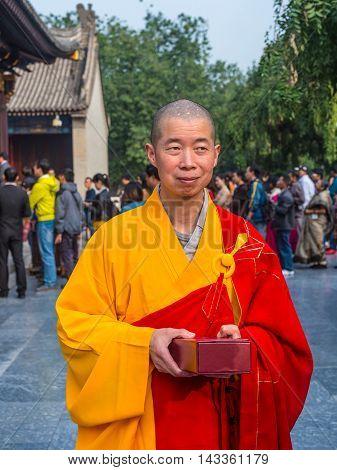 Xian China - October 17 2013: Monk at Giant Wild Goose Pagoda Xi'an Shaanxi Province China.