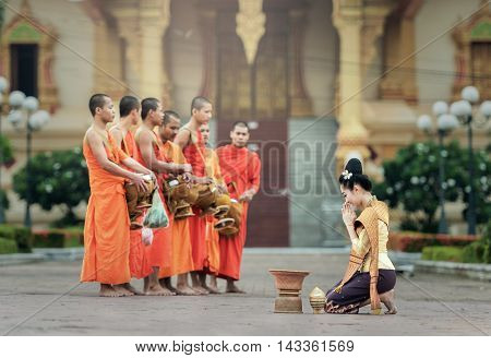 VIENTIANE LAOS - JULY 29 : People give food offerings to Buddhist monks on July 29 2016 in Vientiane Laos.