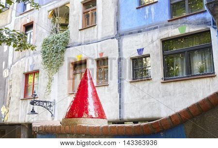 Vienna, Austria - August 15, 2016: Sculpture In Front Of The Hundertwasserhaus, An Apartment Buildin