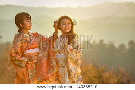 Attractive asian woman wearing traditional Japanese Kimono