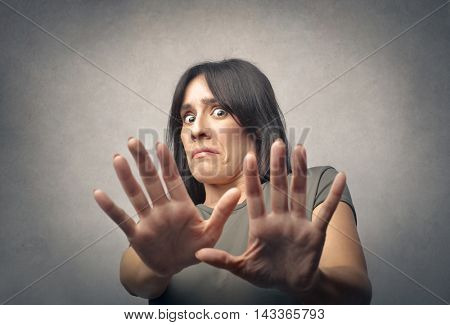Disgusted woman pushing away someone