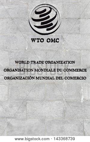 Geneva, Switzerland - August 14, 2016: The World Trade Organization sign on a wall. The World Trade Organization also called WTO is an intergovernmental organization which regulates international trade