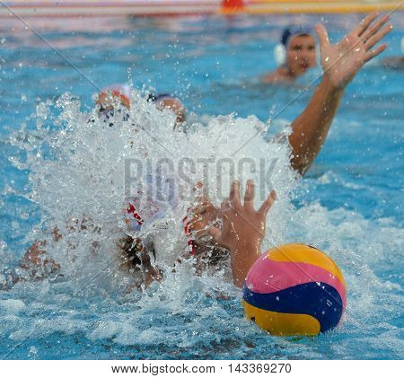 Budapest, Hungary - Jul 17, 2014. Ball, hands and a splash of water. The Waterpolo European Championship was held in Alfred Hajos Swimming Centre in 2014.
