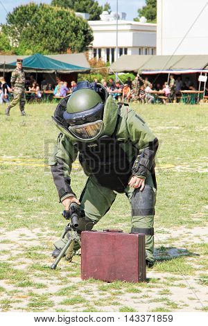 LAUDUN FRANCE - MAY 01 2014: Bomb Squad specialiste and vehicle equipped with a remote-controlled robot detection and detonation equipment during French Foreign legion open Day on May 01 2014