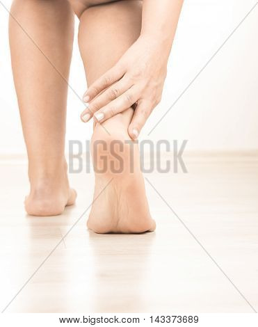woman leg with ankle pain high quality and high resolution studio shoot