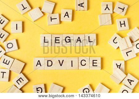 Legal Advice word written on wood block. Wooden ABC.