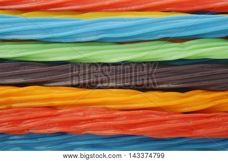 colorful licorice candy shaped like a twisted rope background