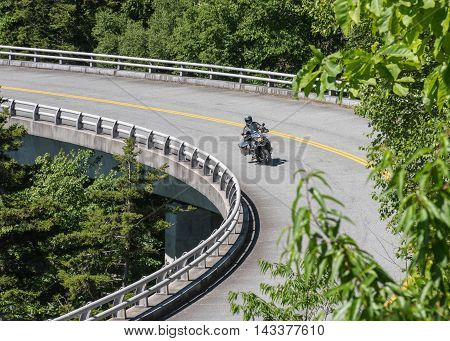 Motorcycle Takes a Bend on the Linn Cove Viaduct in summer