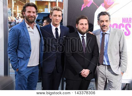 LOS ANGELES - AUG 15:  Bradley Cooper, Miles Teller, Jonah Hill and Todd Phillips arrives to the