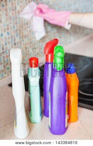 Plastic Bottles With Detergents On Kitchen Worktop