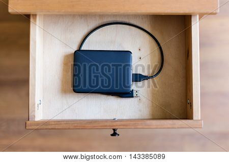 External Hard Drive In Open Drawer