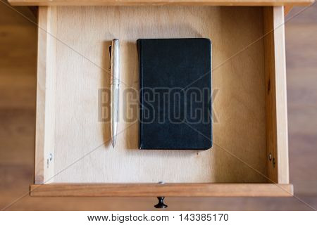 Vintage Pen And Black Notebook In Open Drawer