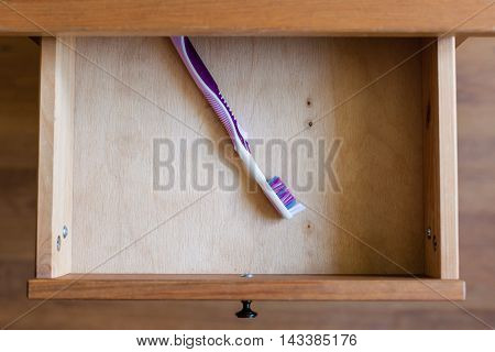 Modern Toothbrush In Open Drawer